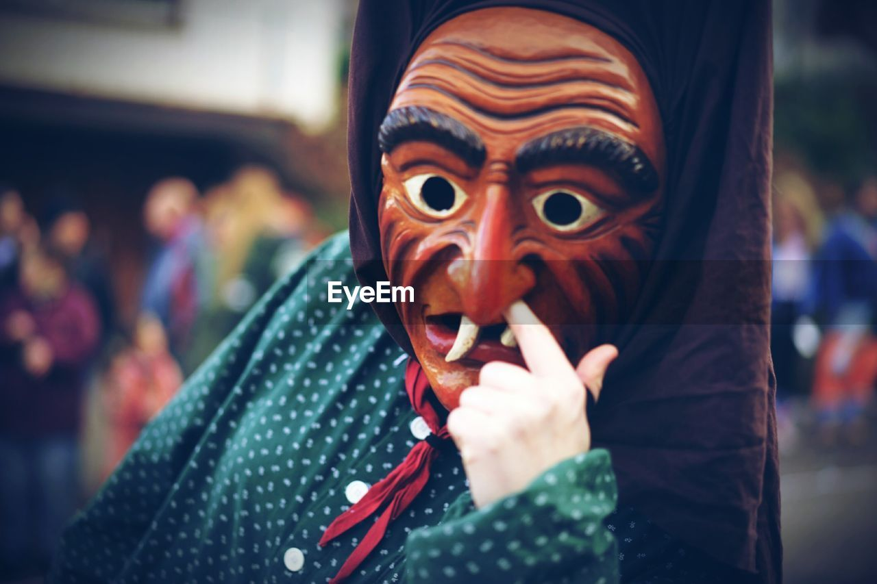 Close-up of person wearing mask at carnival