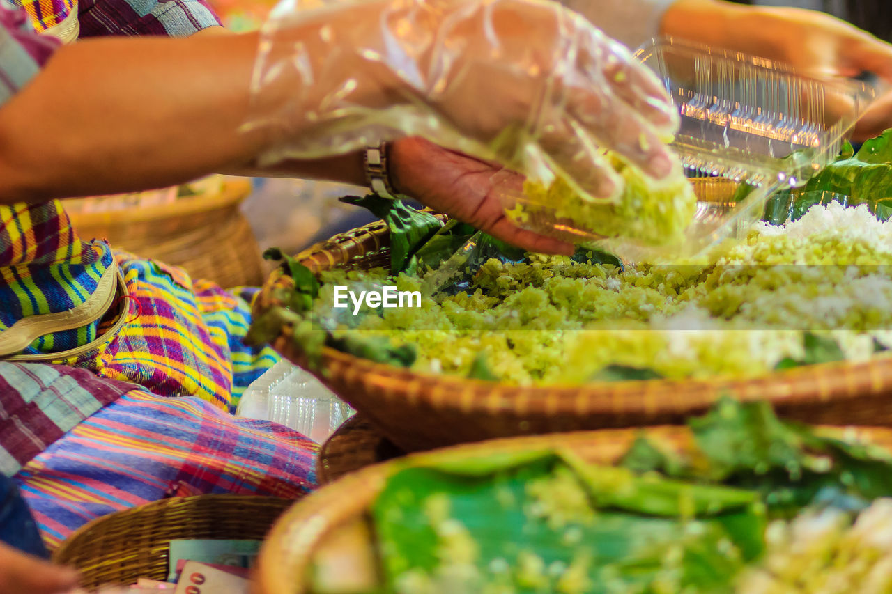 food, food and drink, selective focus, human hand, hand, freshness, one person, indoors, real people, human body part, vegetable, healthy eating, preparation, midsection, preparing food, table, basket, close-up, holding
