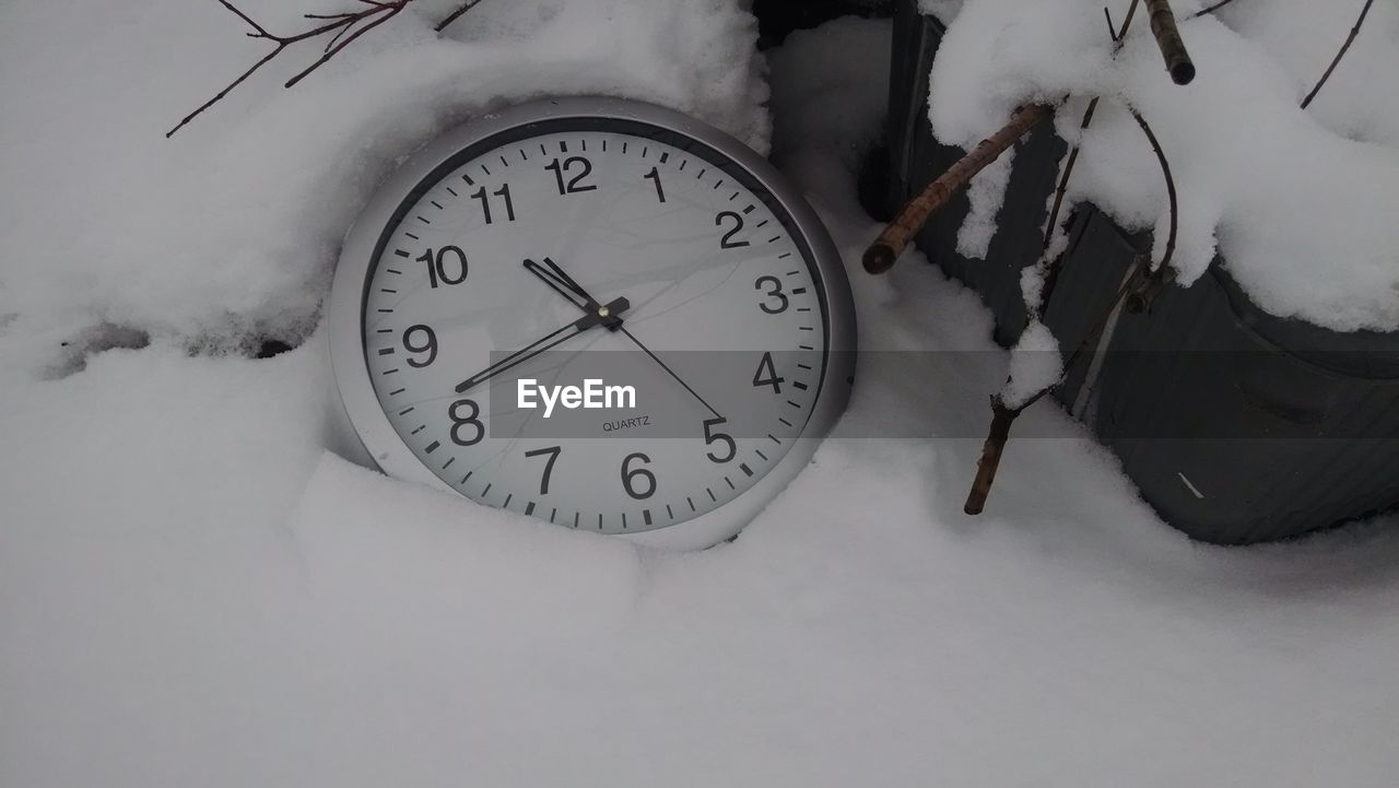 time, clock, snow, winter, cold temperature, number, instrument of time, no people, white color, high angle view, frozen, nature, close-up, indoors, accuracy, day, covering, field, minute hand, clock face