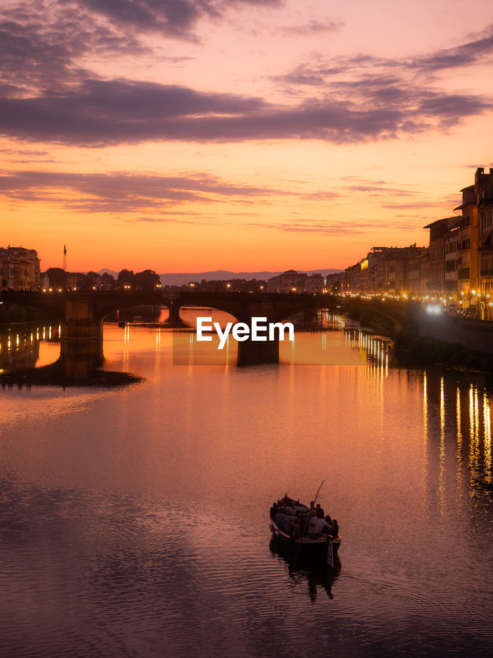 sunset, sky, water, transportation, nautical vessel, architecture, cloud - sky, mode of transportation, orange color, nature, waterfront, built structure, building exterior, reflection, river, city, beauty in nature, dusk, illuminated, outdoors