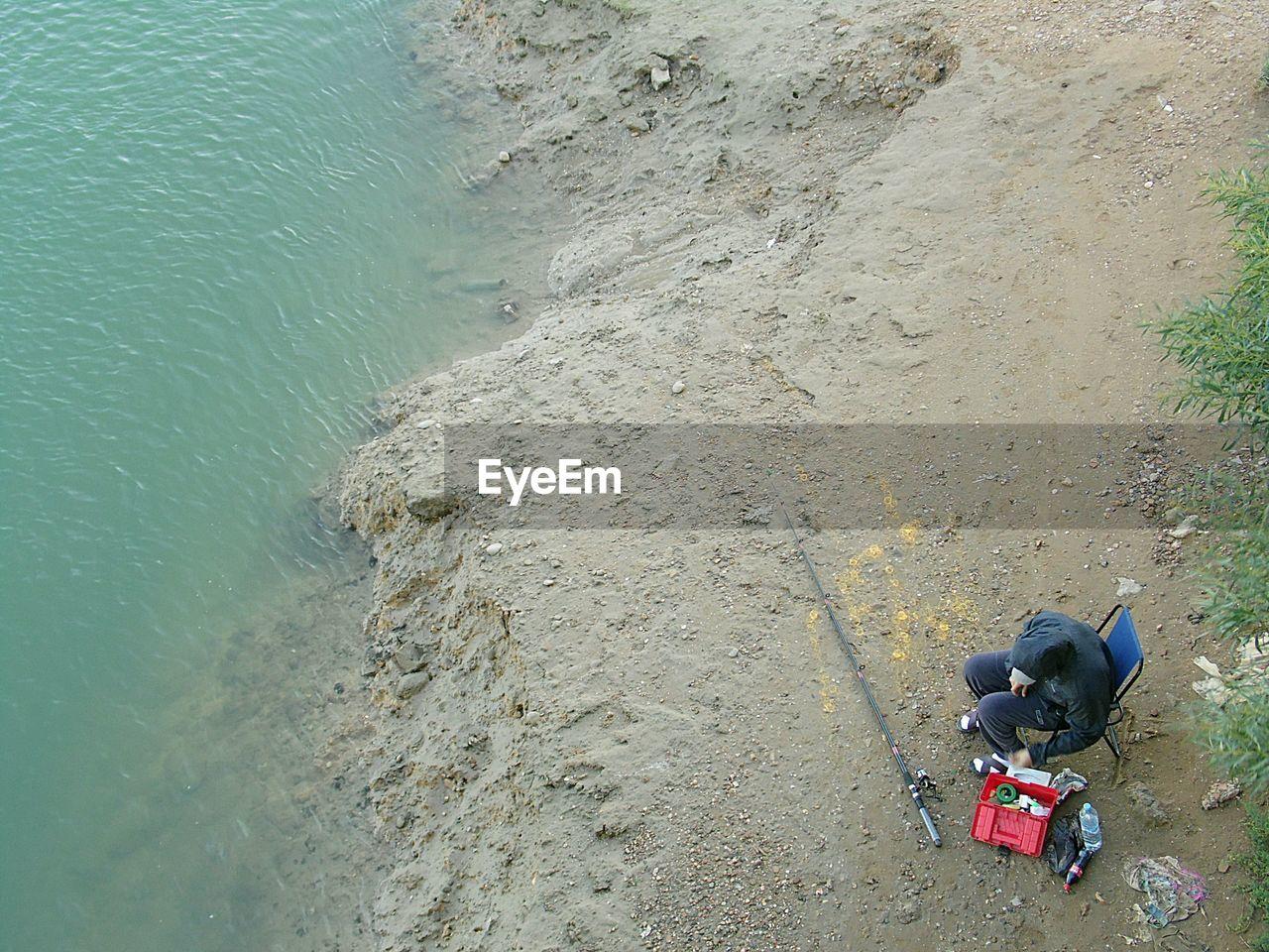 High Angle View Of Man On Riverbank