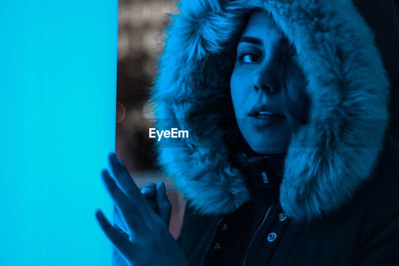 Close-Up Portrait Of Woman Wearing Fur Coat