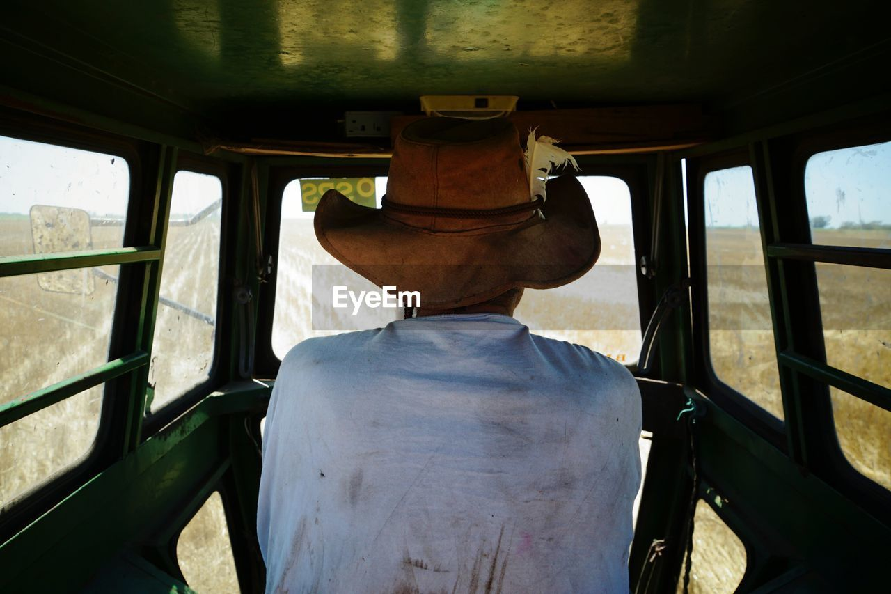 Rear View Of Man In Tractor