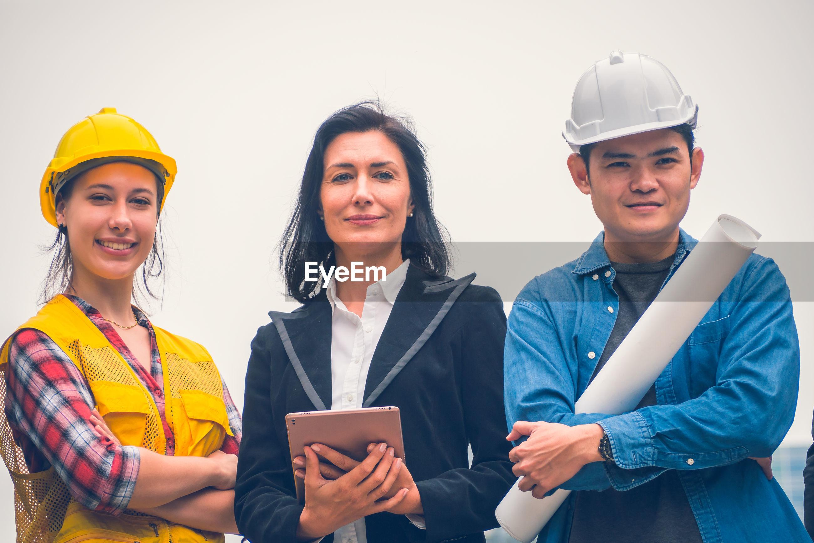 Portrait of three engineers standing outdoors