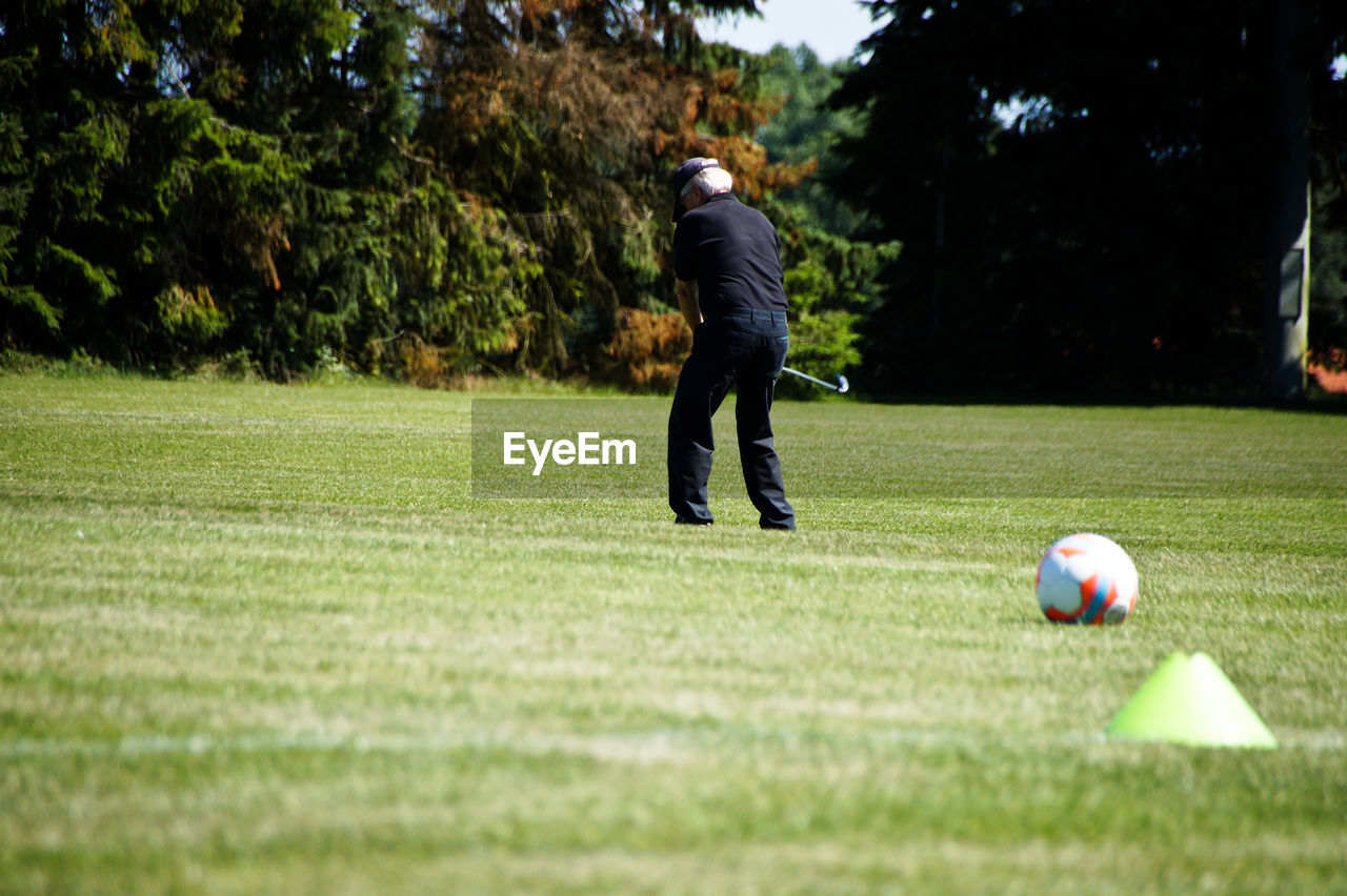 Full Length Of Man Playing With Ball