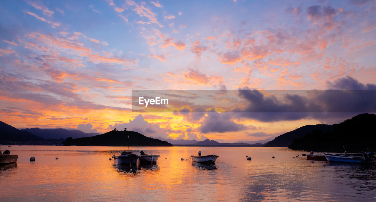 sky, water, cloud - sky, sunset, beauty in nature, scenics - nature, nautical vessel, tranquility, tranquil scene, sea, transportation, mountain, waterfront, nature, mode of transportation, idyllic, no people, reflection, orange color, outdoors, yacht