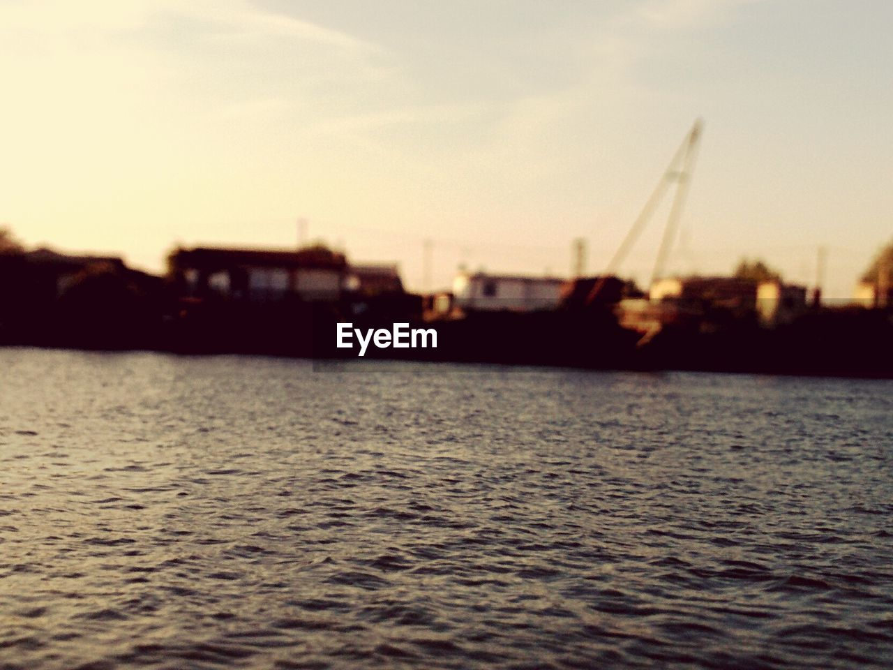 water, sunset, waterfront, rippled, no people, sky, river, nautical vessel, silhouette, outdoors, building exterior, architecture, nature, tranquility, built structure, beauty in nature, scenics, sailing, city, day