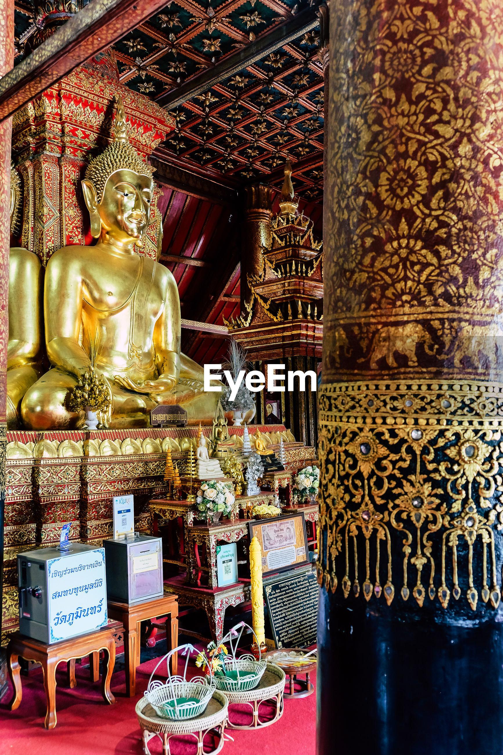 BUDDHA STATUE IN TEMPLE BUILDING