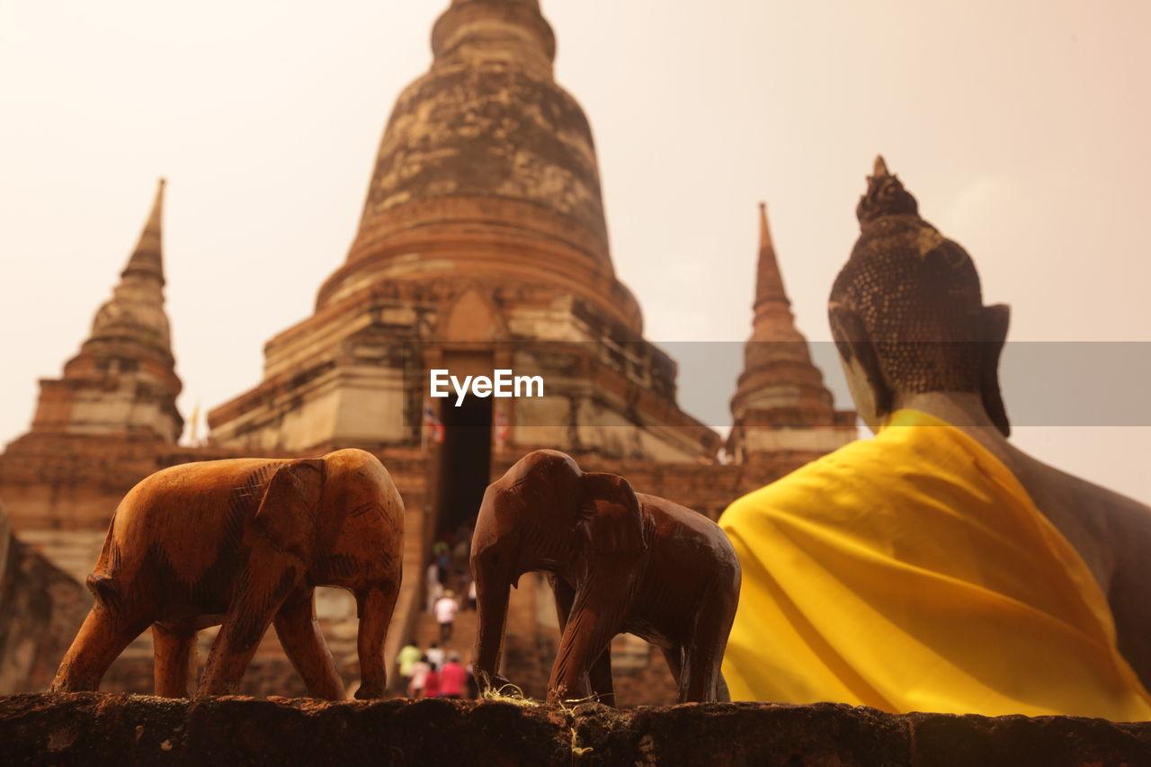Statues Of Buddha And Elephants At Wat Yai Chai Mongkhon Temple