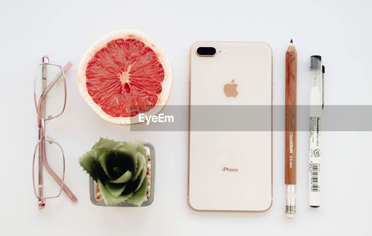 indoors, food and drink, still life, food, directly above, studio shot, freshness, high angle view, white background, healthy eating, no people, wellbeing, table, fruit, citrus fruit, vegetable, close-up, group of objects, green color, cutting board, tray, orange