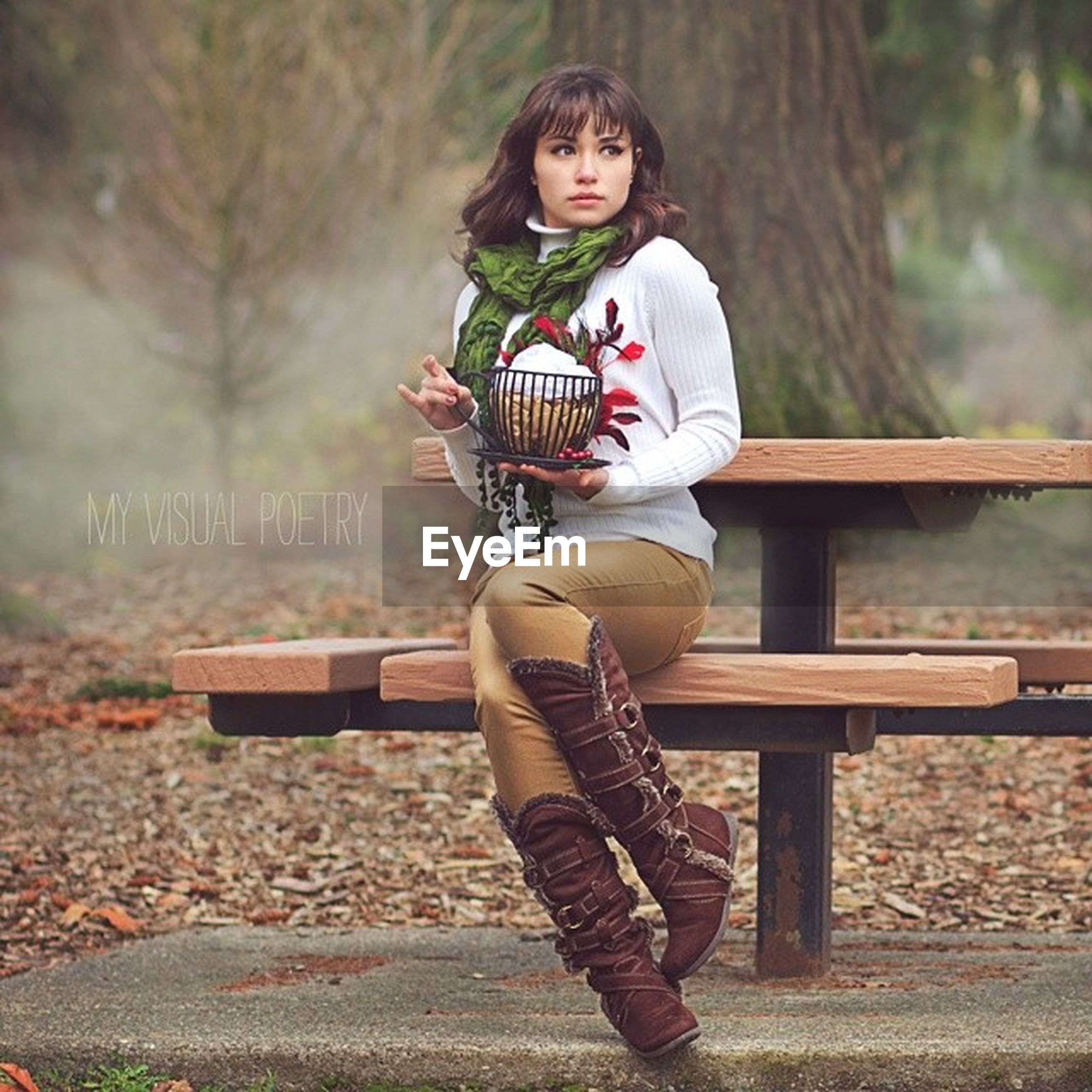person, casual clothing, lifestyles, young adult, leisure activity, full length, front view, standing, looking at camera, smiling, portrait, happiness, holding, three quarter length, focus on foreground, childhood, young women, sitting