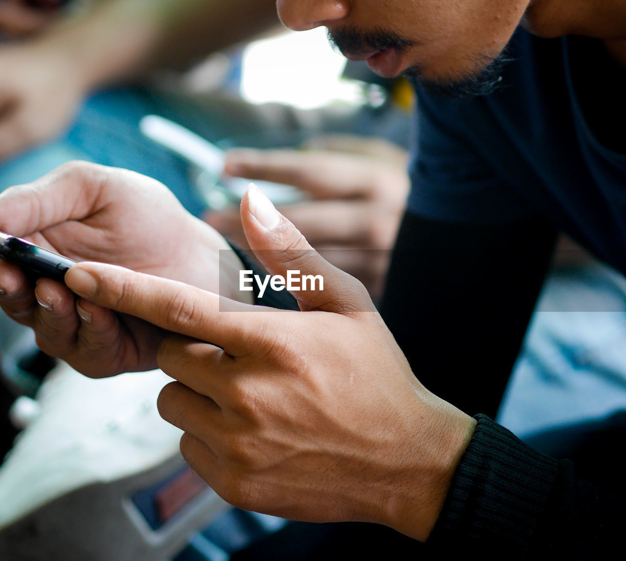 Close-up of using smart phone