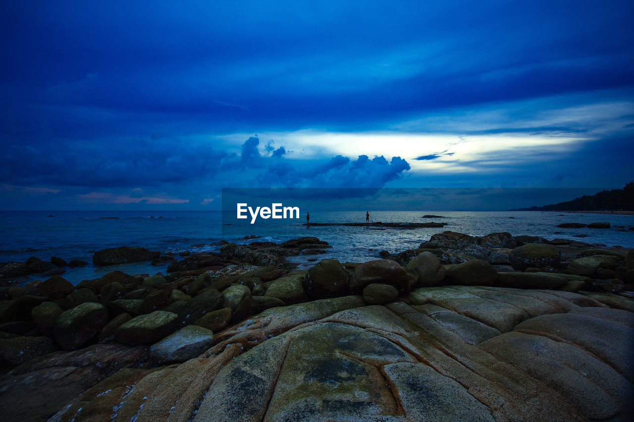 sky, sea, cloud - sky, water, scenics - nature, beauty in nature, rock, solid, rock - object, horizon over water, tranquil scene, horizon, nature, tranquility, beach, blue, land, idyllic, no people, groyne