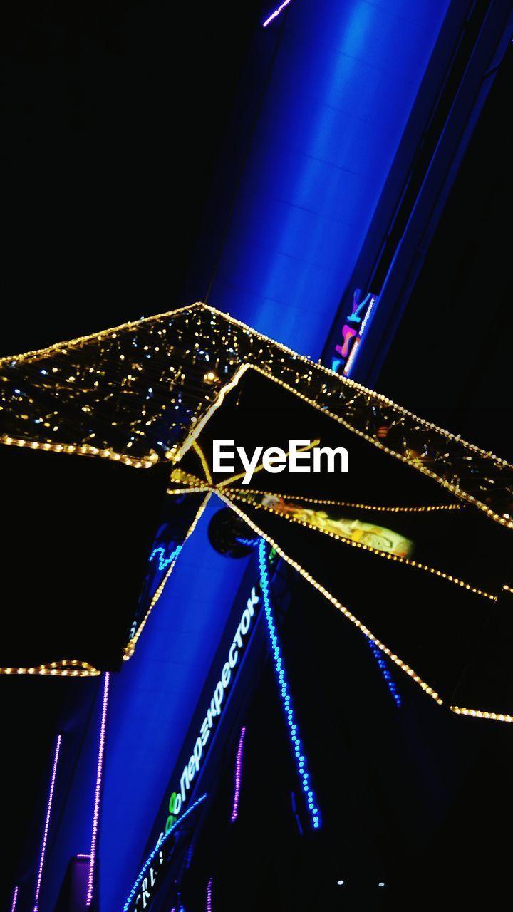 night, illuminated, low angle view, built structure, blue, amusement park, no people, outdoors, architecture, arts culture and entertainment, amusement park ride, black background, neon, close-up, city