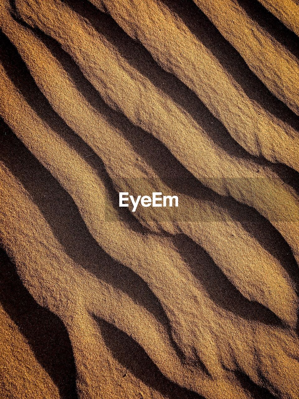 backgrounds, full frame, pattern, no people, textured, sand, land, nature, natural pattern, brown, close-up, day, textile, wave pattern, outdoors, rough, sunlight, abstract, wood - material, landscape, arid climate, climate, clean