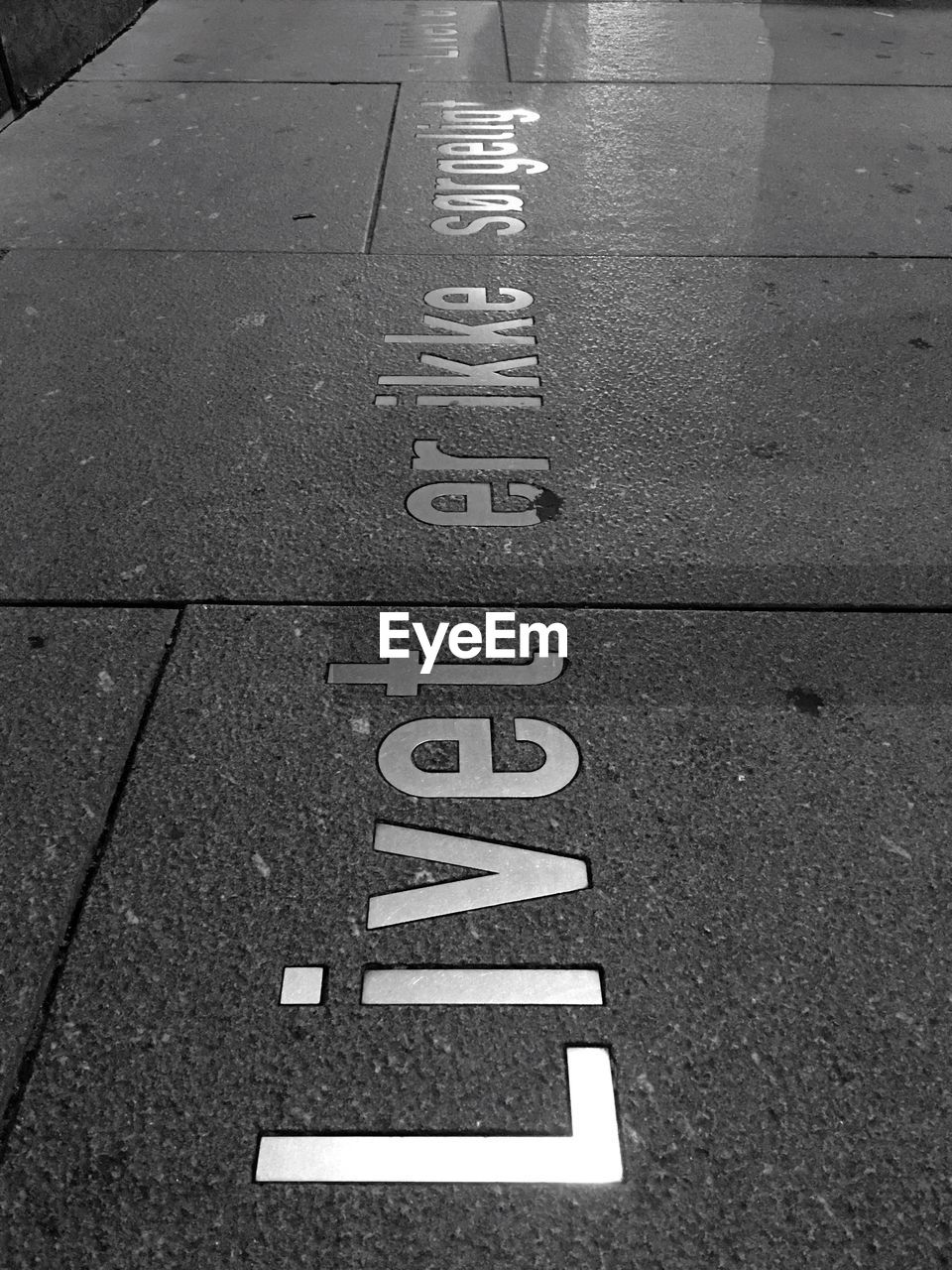 High Angle View Of Text On Pavement In City