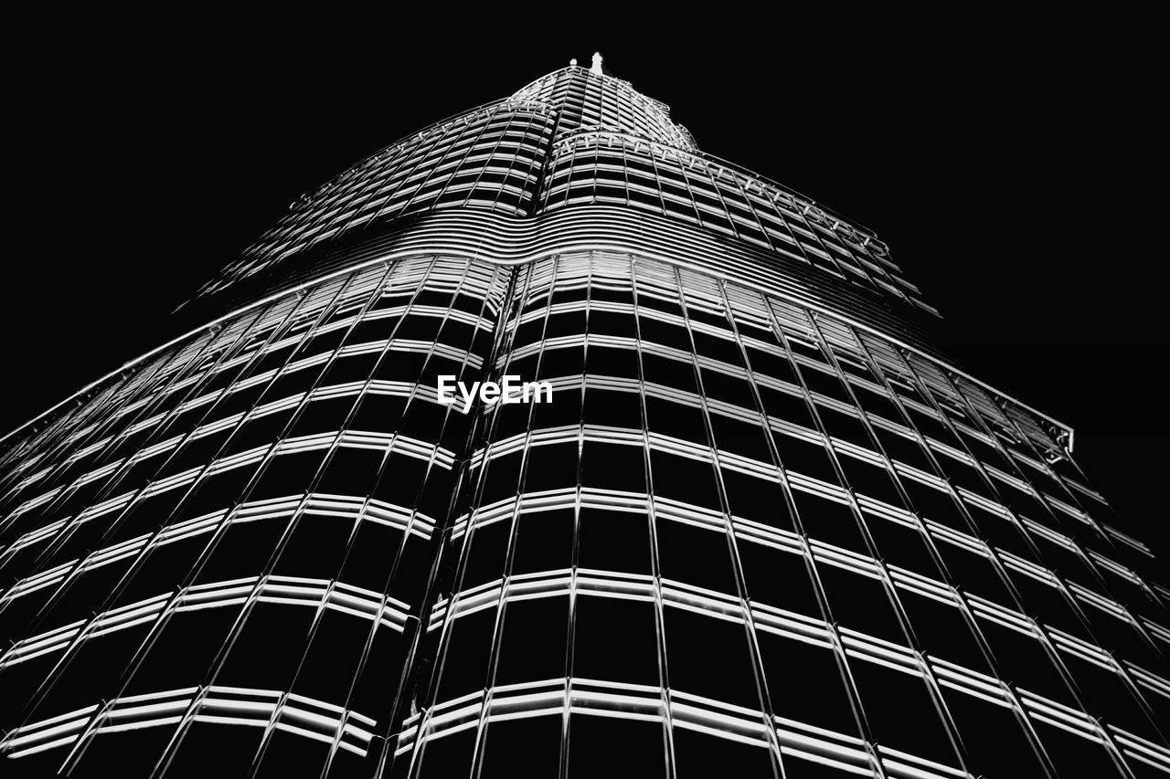 low angle view, architecture, building exterior, modern, built structure, night, skyscraper, no people, clear sky, travel destinations, illuminated, outdoors, city, sky