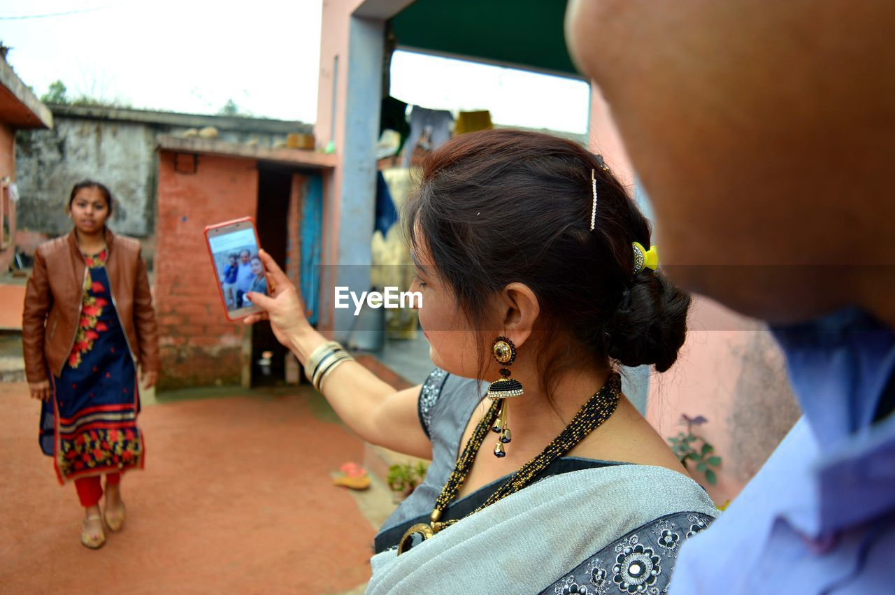 Woman taking selfie with phone