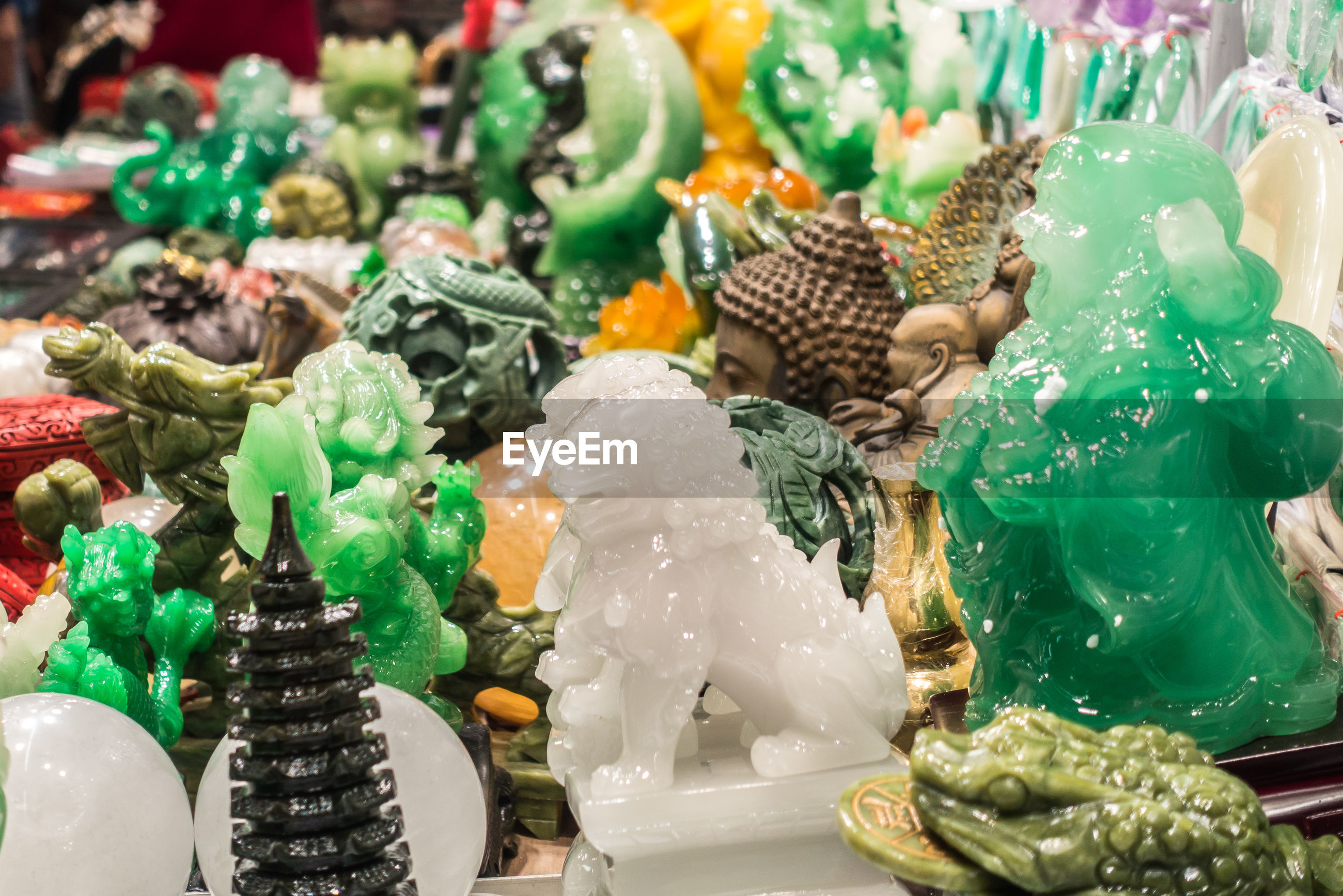 High angle view of multi colored statues for sale