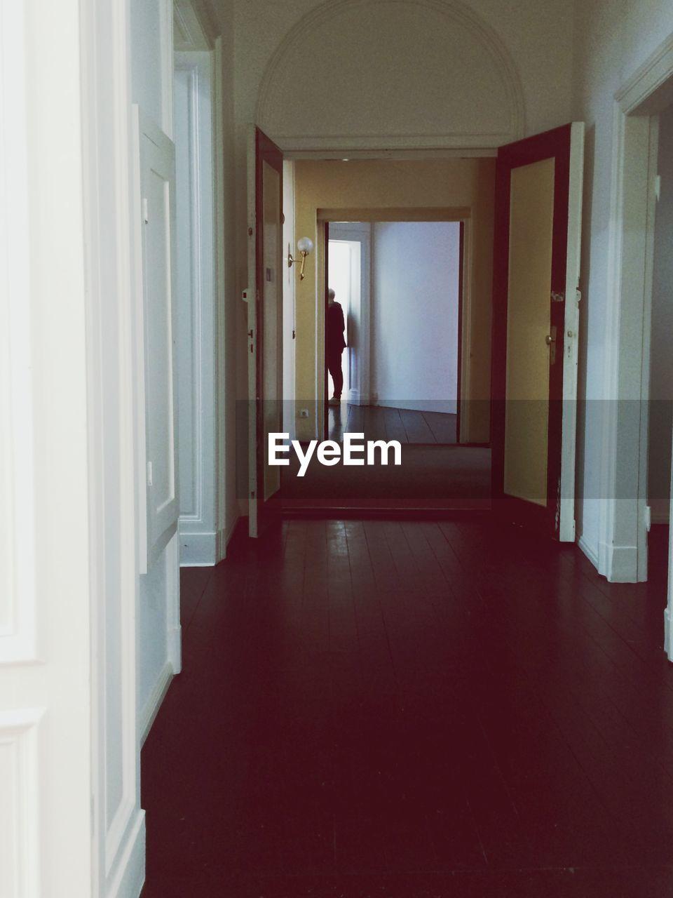 Corridor leading towards door