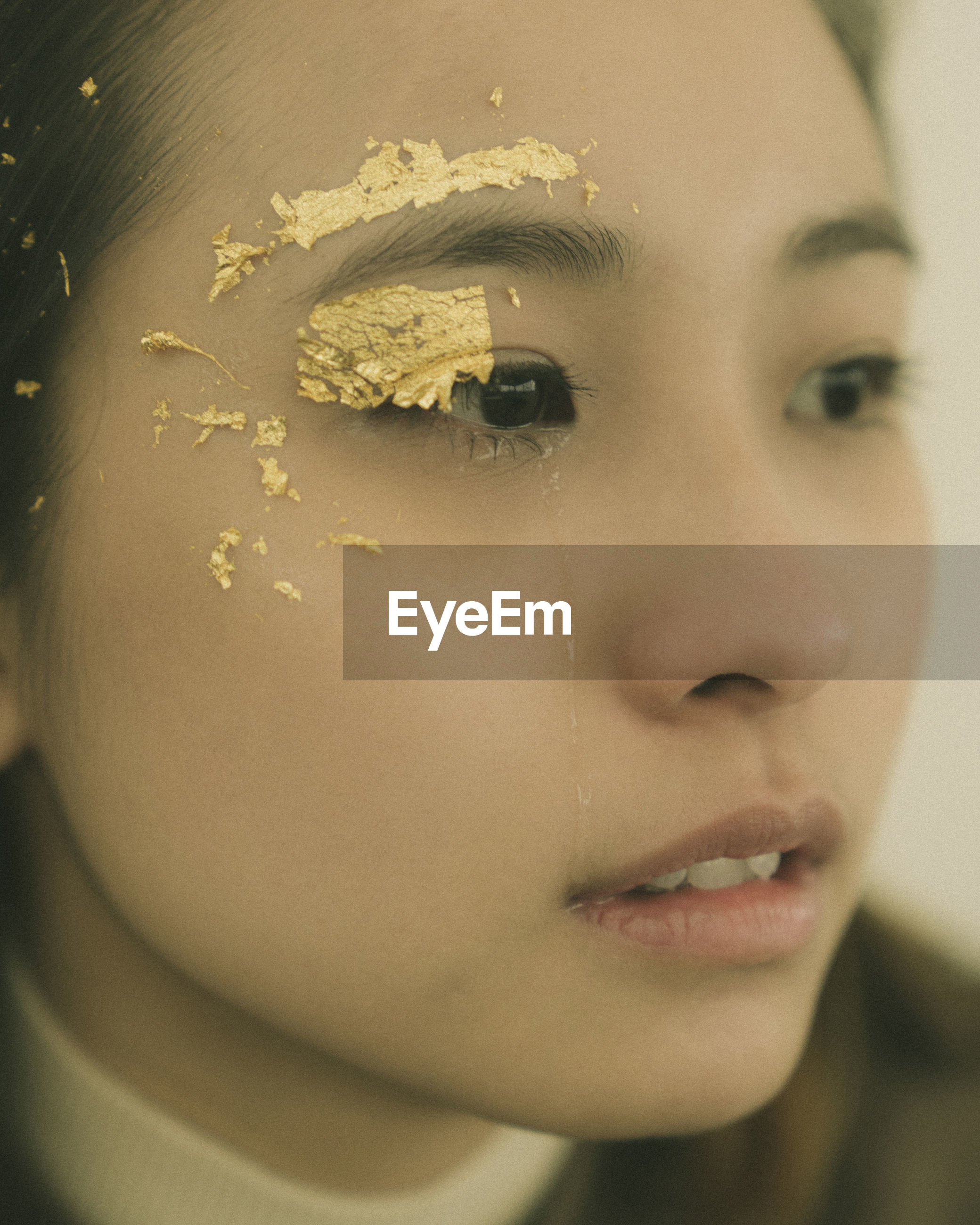 Close-up of sad young woman looking away