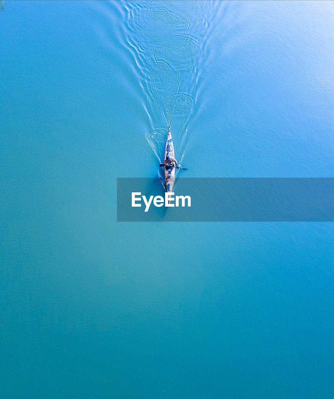 High Angle View Of Man Kayaking On Lake
