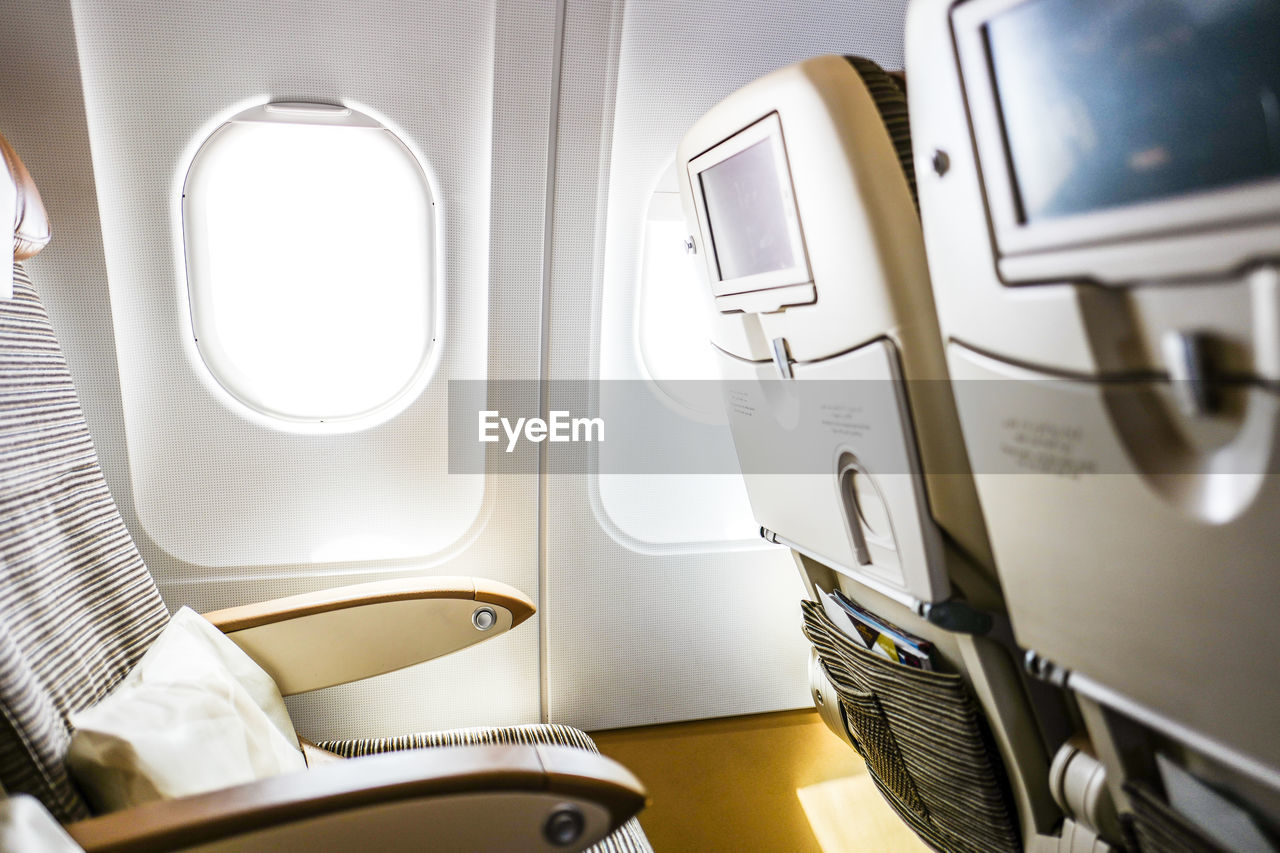 vehicle interior, transportation, indoors, airplane, window, no people, travel, journey, vehicle seat, airplane seat, seat, commercial airplane, day, close-up