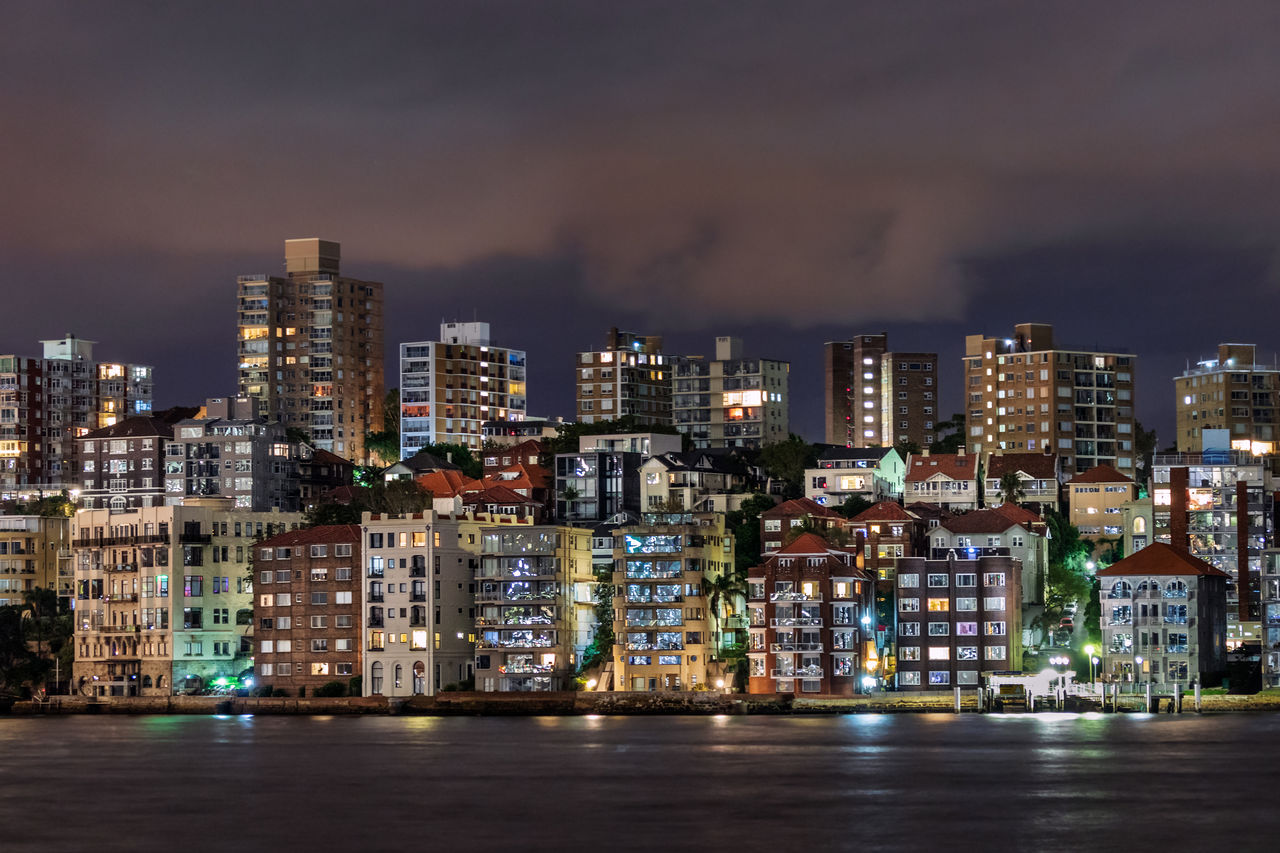Residential and commercial buildings at sydney harbor at night, australia.