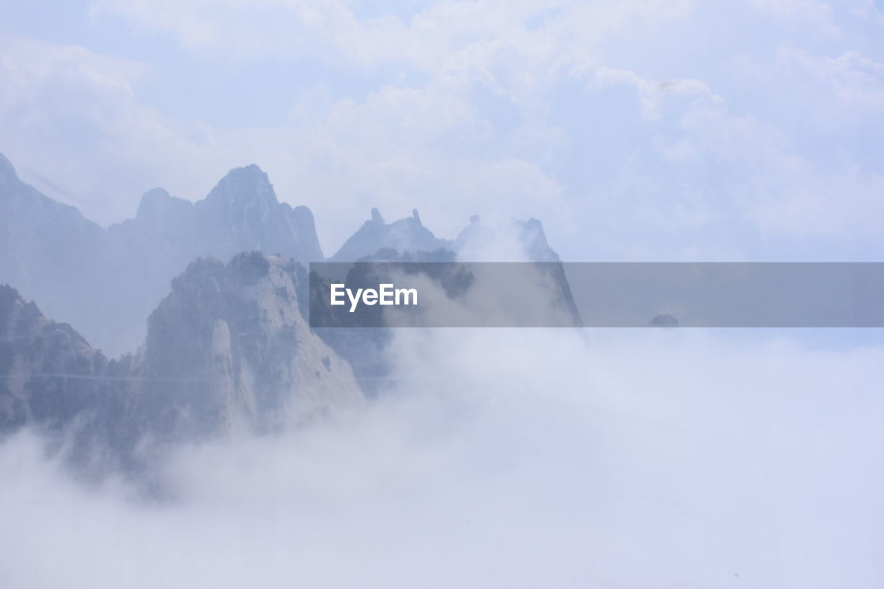 mountain, beauty in nature, nature, sky, fog, day, outdoors, no people, scenics, scenery