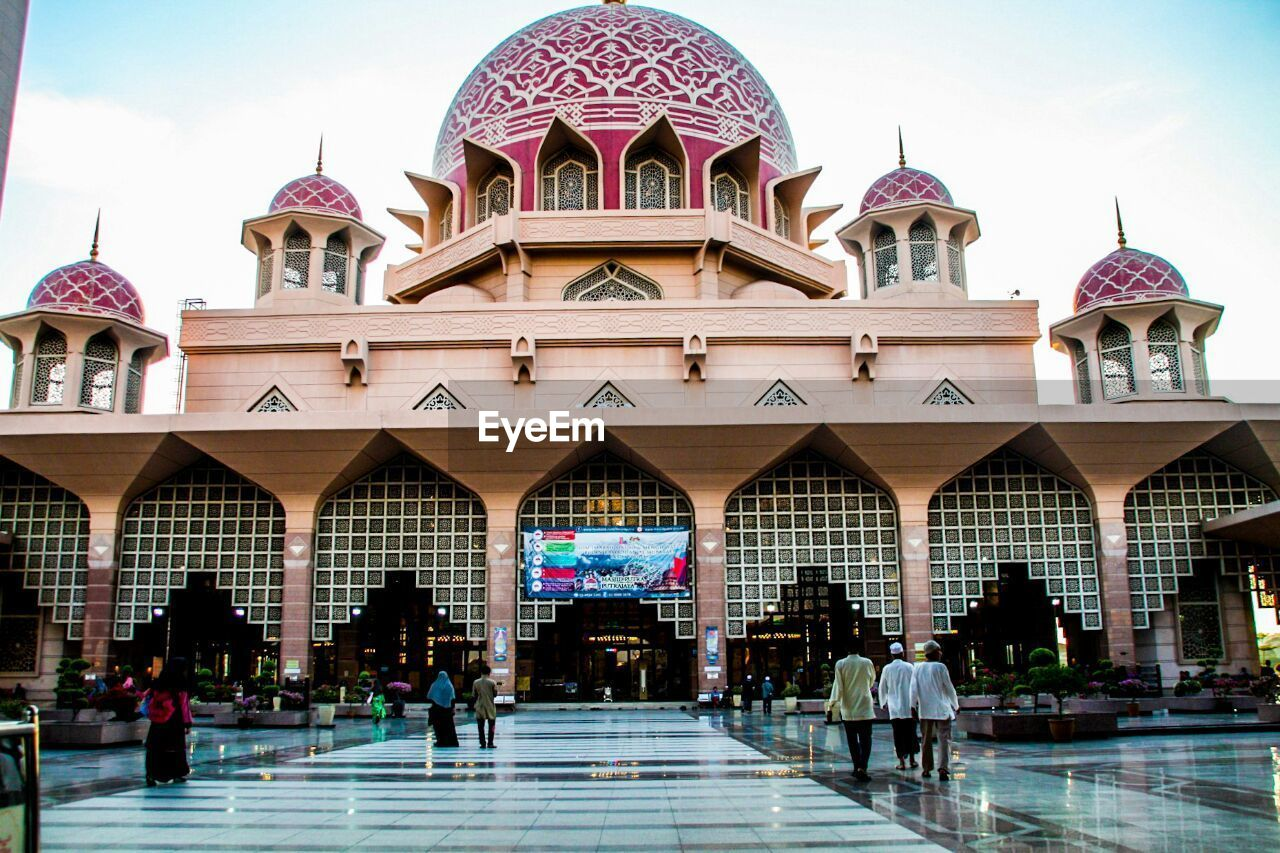 architecture, dome, religion, place of worship, arch, built structure, building exterior, travel destinations, spirituality, travel, real people, day, large group of people, outdoors, group of people, sky, people, adult