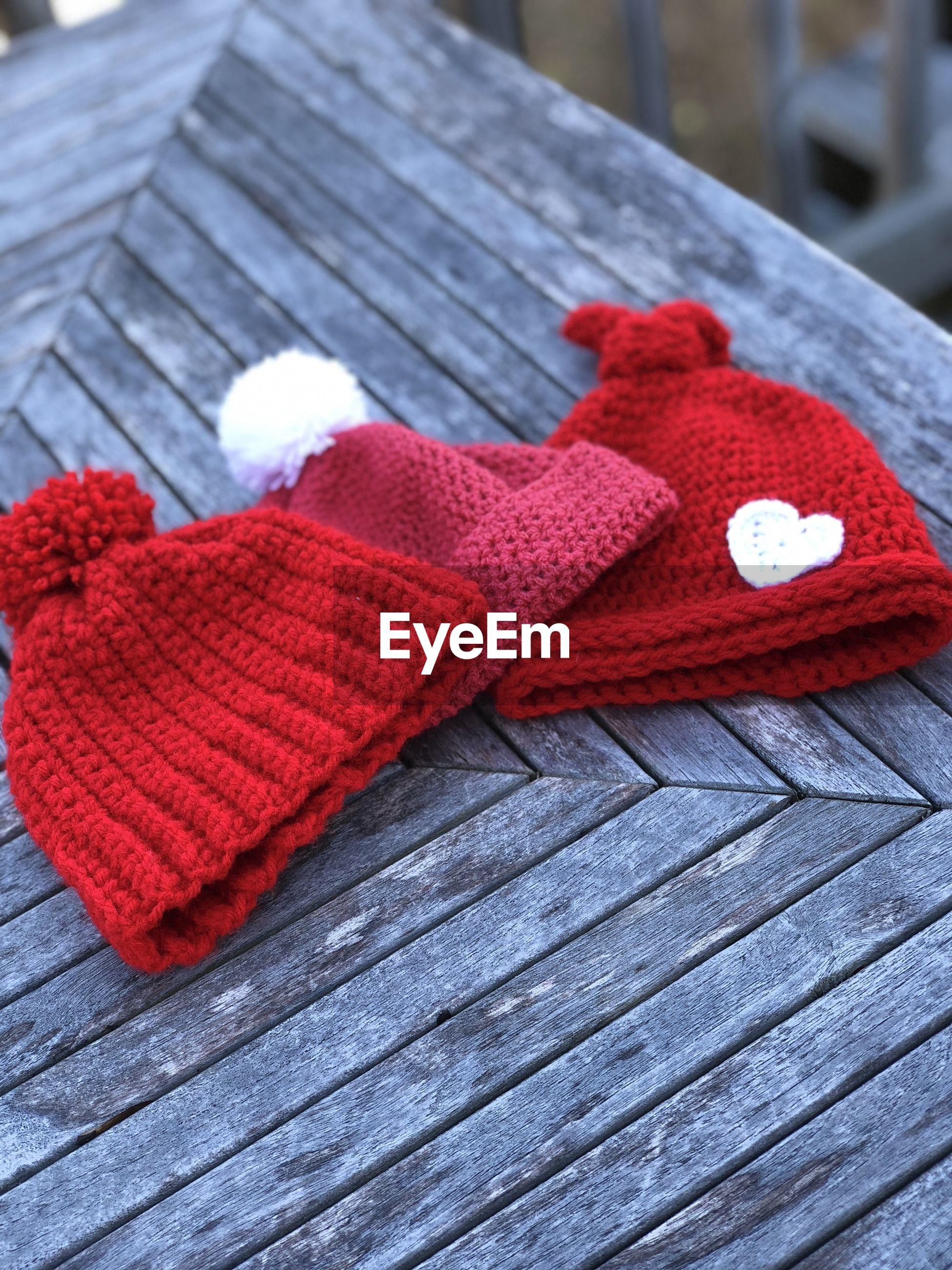 High angle view of knit hats on wooden table