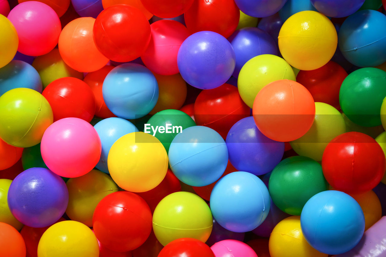 multi colored, large group of objects, full frame, no people, backgrounds, balloon, abundance, indoors, variation, choice, still life, close-up, red, design, high angle view, shape, ball, day, helium balloon, inflatable