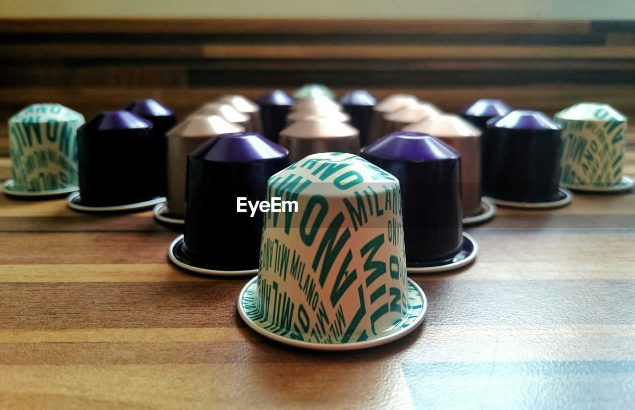 High angle view of coffee capsules arranged on table