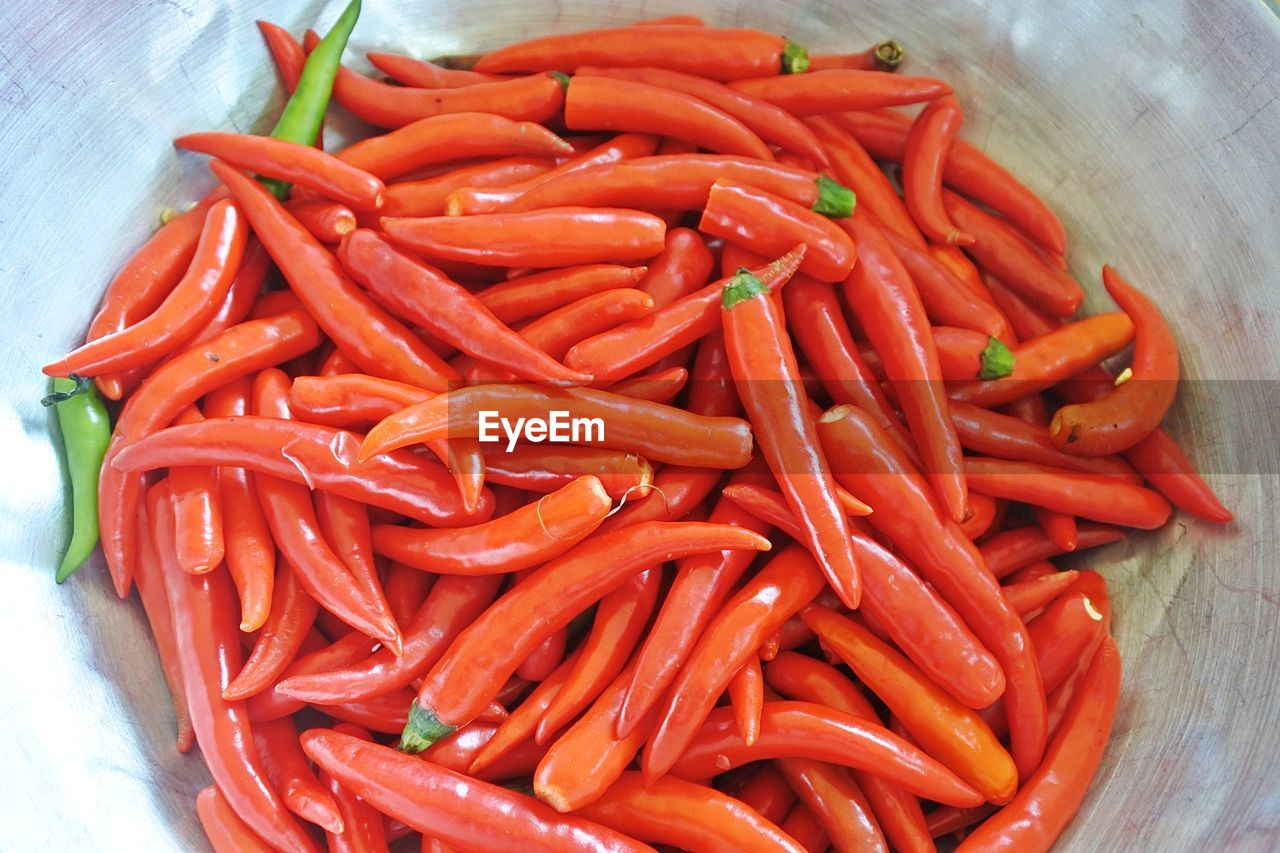vegetable, food and drink, food, red, freshness, still life, high angle view, pepper, spice, close-up, healthy eating, chili pepper, indoors, no people, wellbeing, large group of objects, red chili pepper, carrot, abundance, orange color