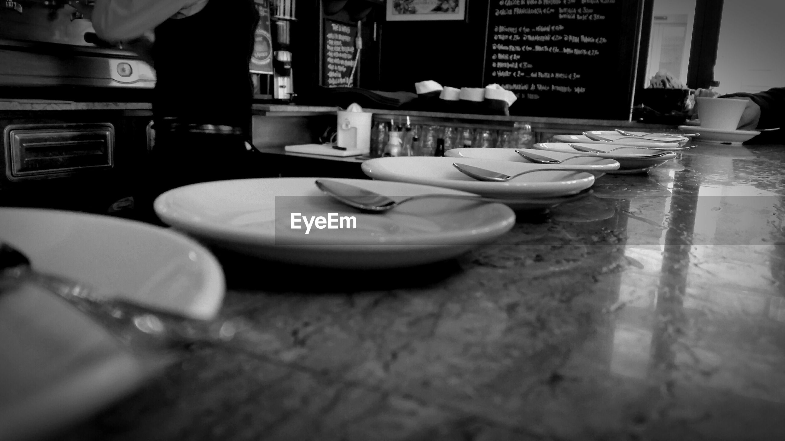 indoors, communication, text, table, food and drink, western script, still life, close-up, selective focus, book, food, paper, restaurant, focus on foreground, non-western script, one person, freshness, education, business