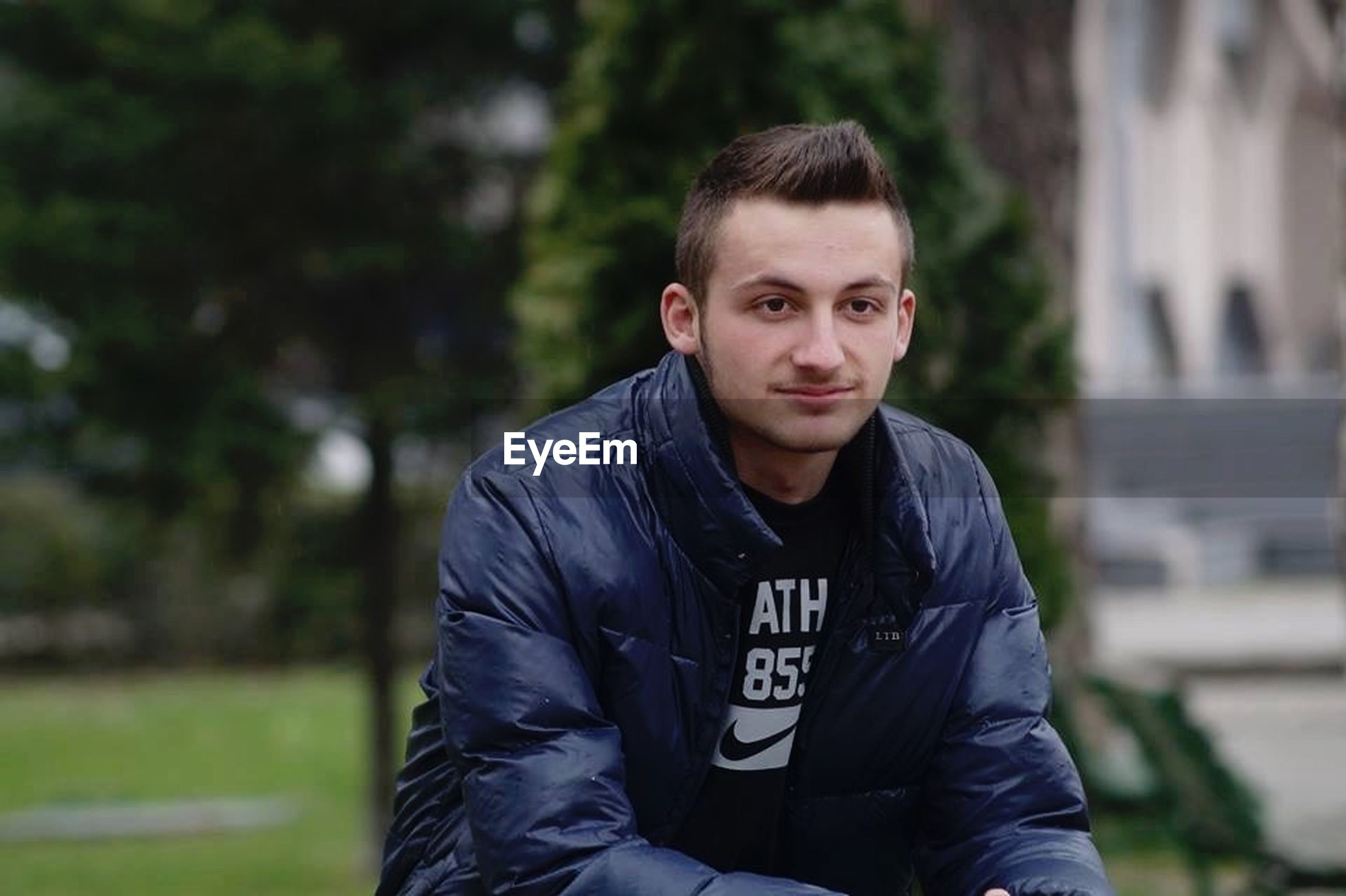 person, casual clothing, portrait, looking at camera, waist up, lifestyles, focus on foreground, front view, leisure activity, young men, smiling, standing, young adult, three quarter length, handsome, jacket, happiness