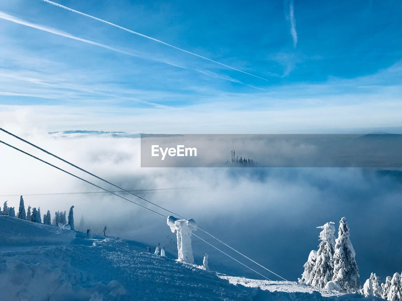 sky, cloud - sky, cold temperature, winter, scenics - nature, nature, snow, beauty in nature, connection, tranquil scene, mountain, transportation, day, tranquility, no people, cable, non-urban scene, environment, white color, outdoors, vapor trail, snowcapped mountain