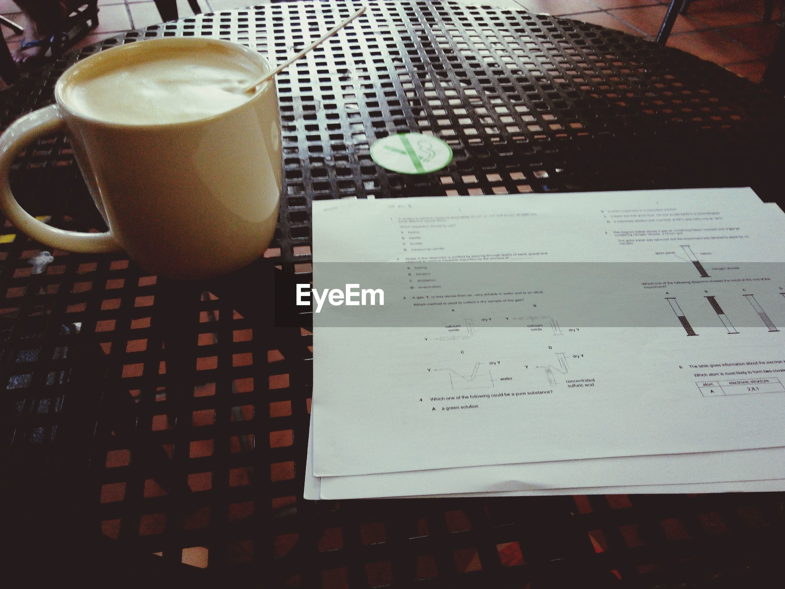 indoors, table, food and drink, high angle view, still life, drink, close-up, coffee cup, freshness, refreshment, paper, no people, coffee - drink, book, text, communication, restaurant, cup, elevated view, day