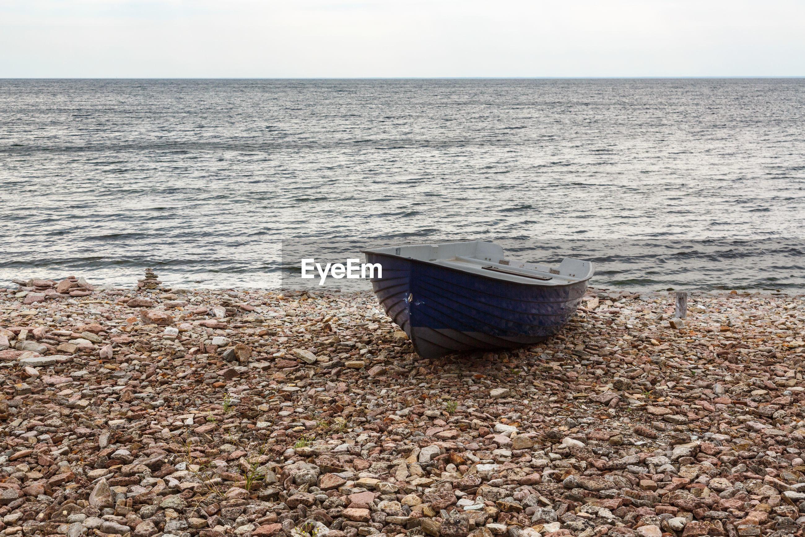 DECK CHAIR ON SHORE AGAINST SEA