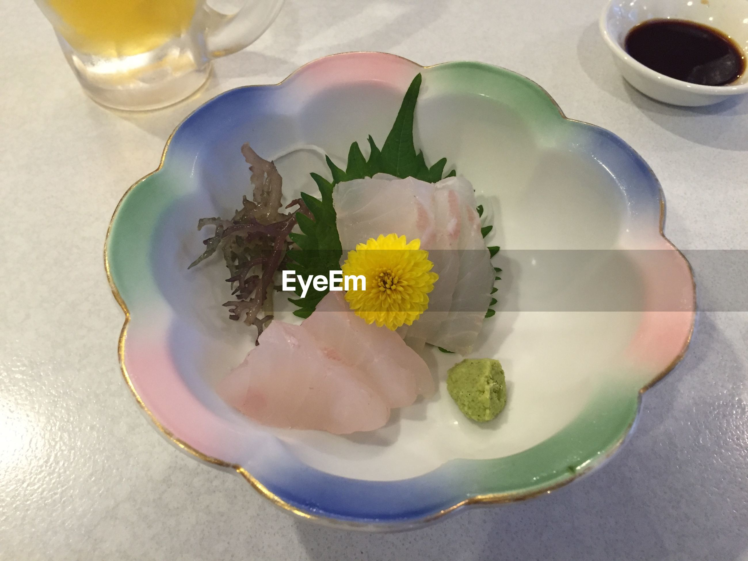 freshness, indoors, flower, table, food and drink, still life, high angle view, drink, petal, vase, refreshment, drinking glass, plate, close-up, bowl, flower head, directly above, yellow, fragility, healthy eating