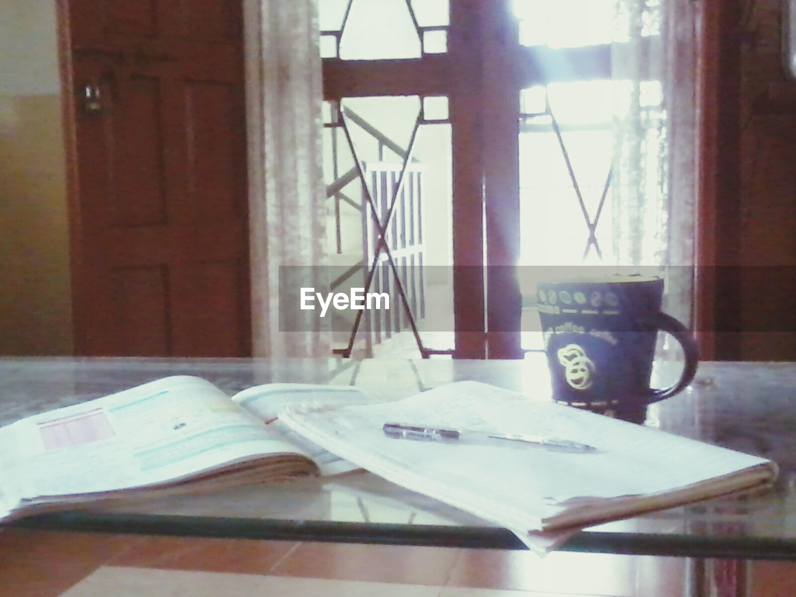 indoors, table, home interior, window, chair, still life, absence, communication, empty, domestic room, book, close-up, no people, glass - material, open, coffee cup, text, paper, day, house
