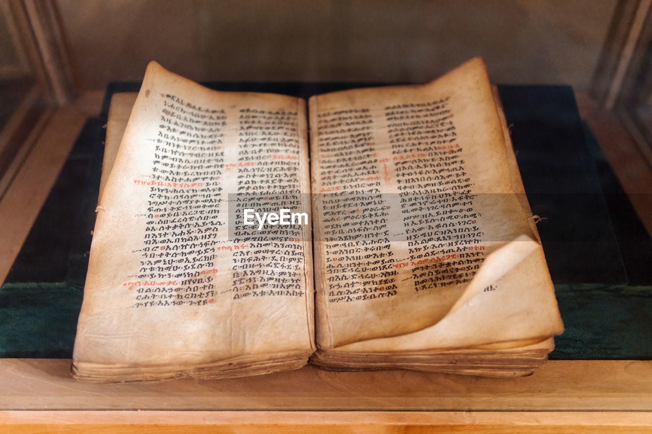 CLOSE-UP OF TEXT ON BOOK