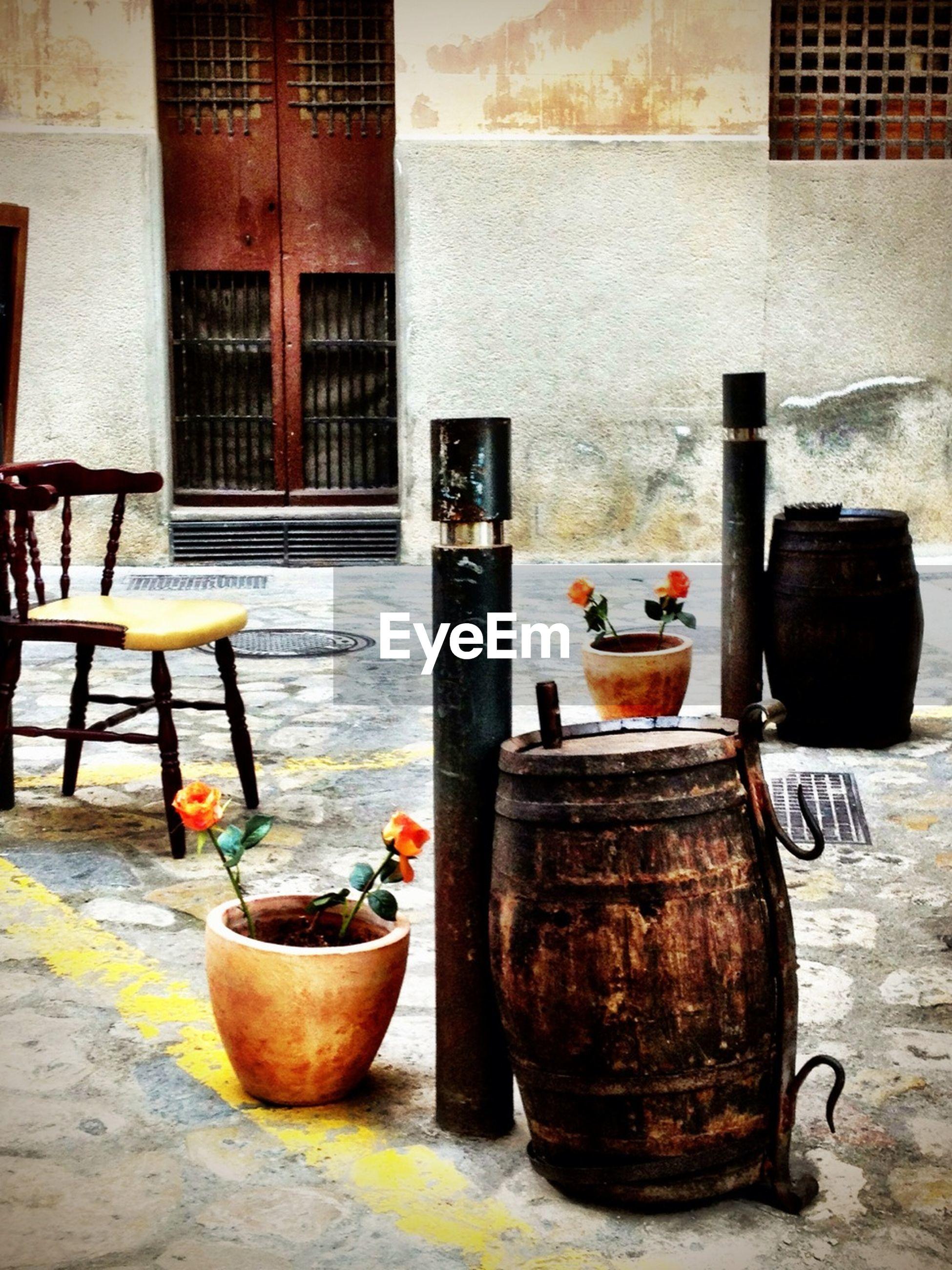 Barrels with flower pots in courtyard