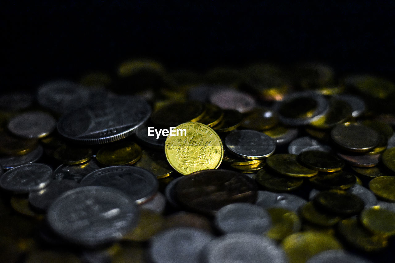 finance, coin, currency, wealth, selective focus, business, large group of objects, savings, no people, indoors, close-up, still life, abundance, high angle view, investment, table, shape, business finance and industry, number, economy, black background