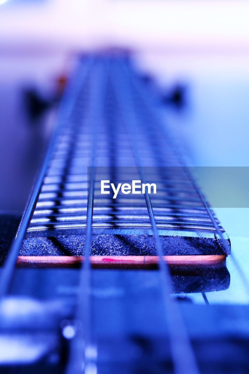 music, musical instrument, close-up, selective focus, still life, indoors, no people, musical instrument string, fretboard, guitar, day