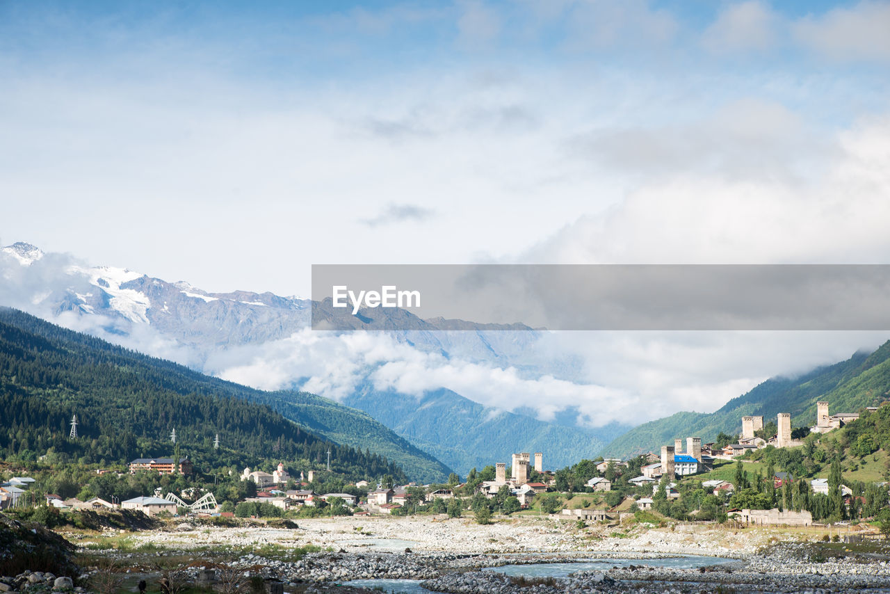 mountain, sky, cloud - sky, architecture, built structure, building exterior, landscape, scenics - nature, environment, beauty in nature, nature, building, city, mountain range, day, no people, outdoors, residential district, tree, town, range, mountain peak, townscape