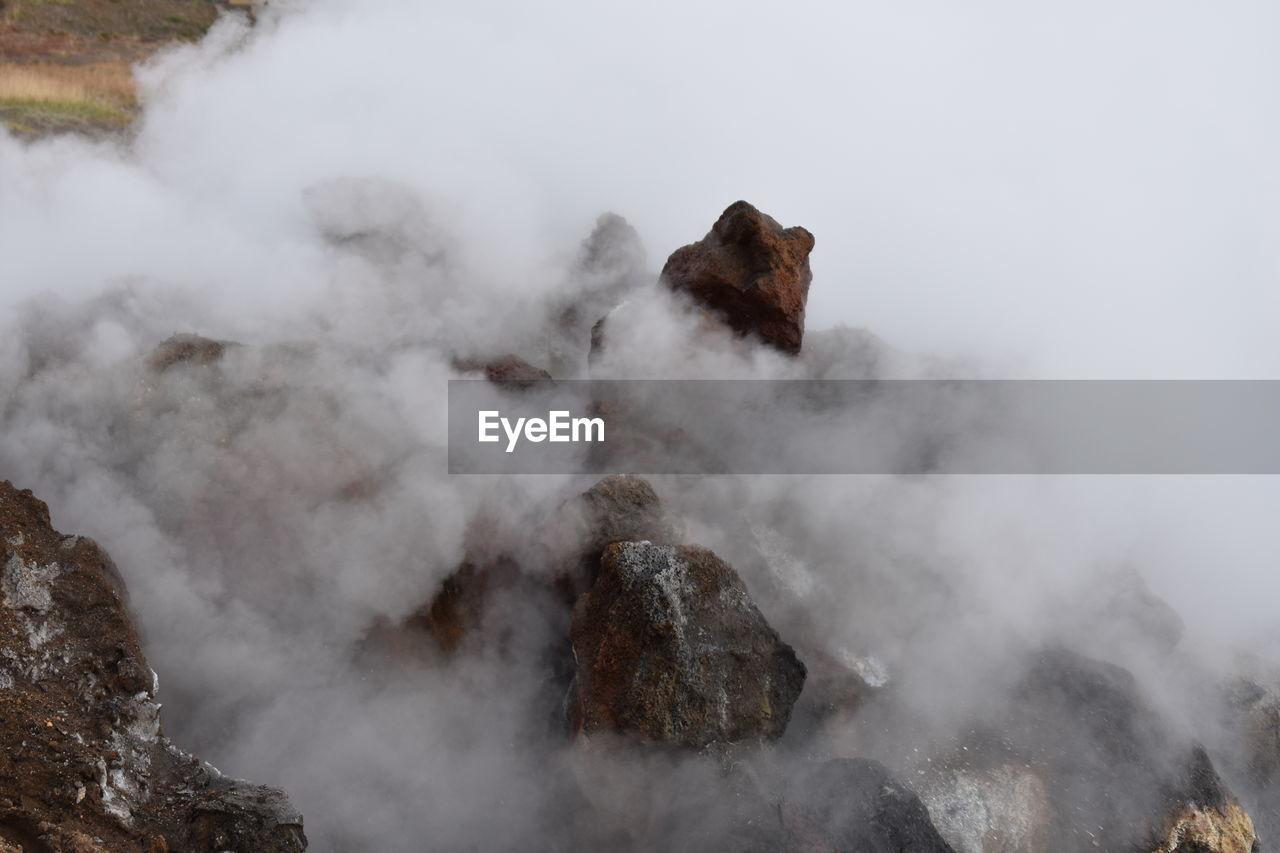 Smoke Emitting From Rock Formation