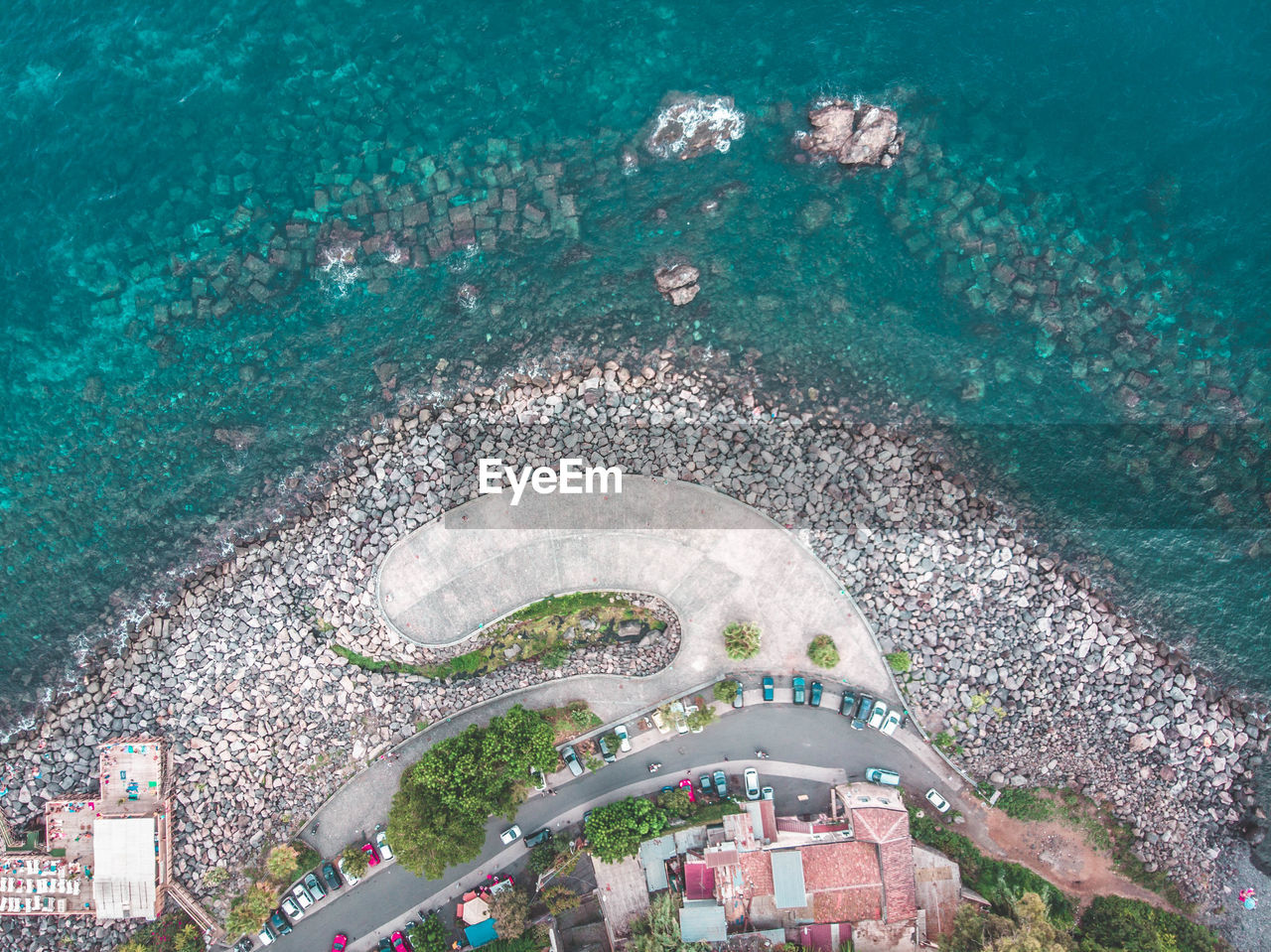 sea, high angle view, water, nature, architecture, aerial view, city, day, outdoors, building exterior, built structure, beach, people, travel, land, travel destinations, plant