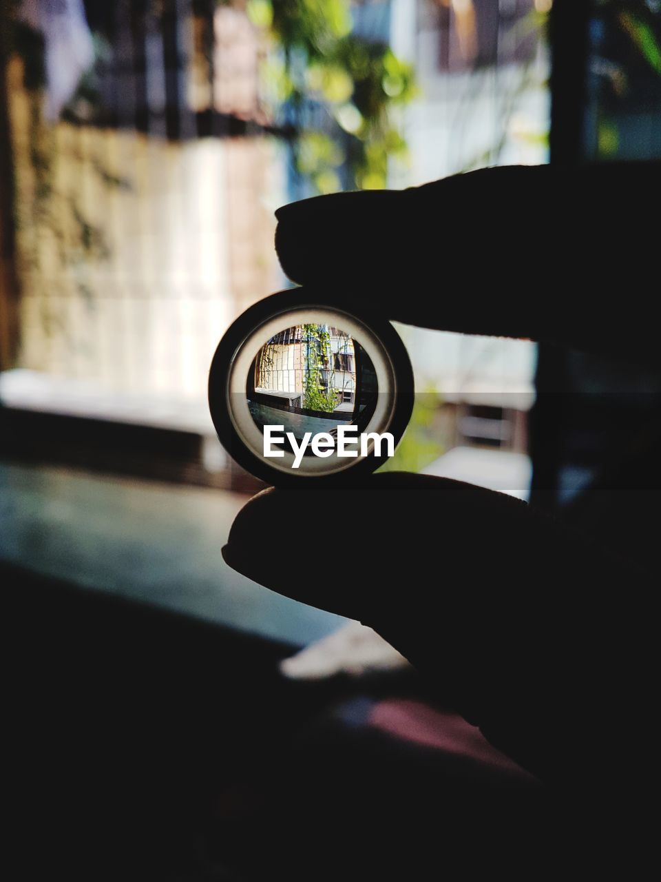 human hand, human body part, close-up, one person, holding, window, real people, focus on foreground, car, day, transportation, photographing, land vehicle, photography themes, indoors, men, technology, camera - photographic equipment, people