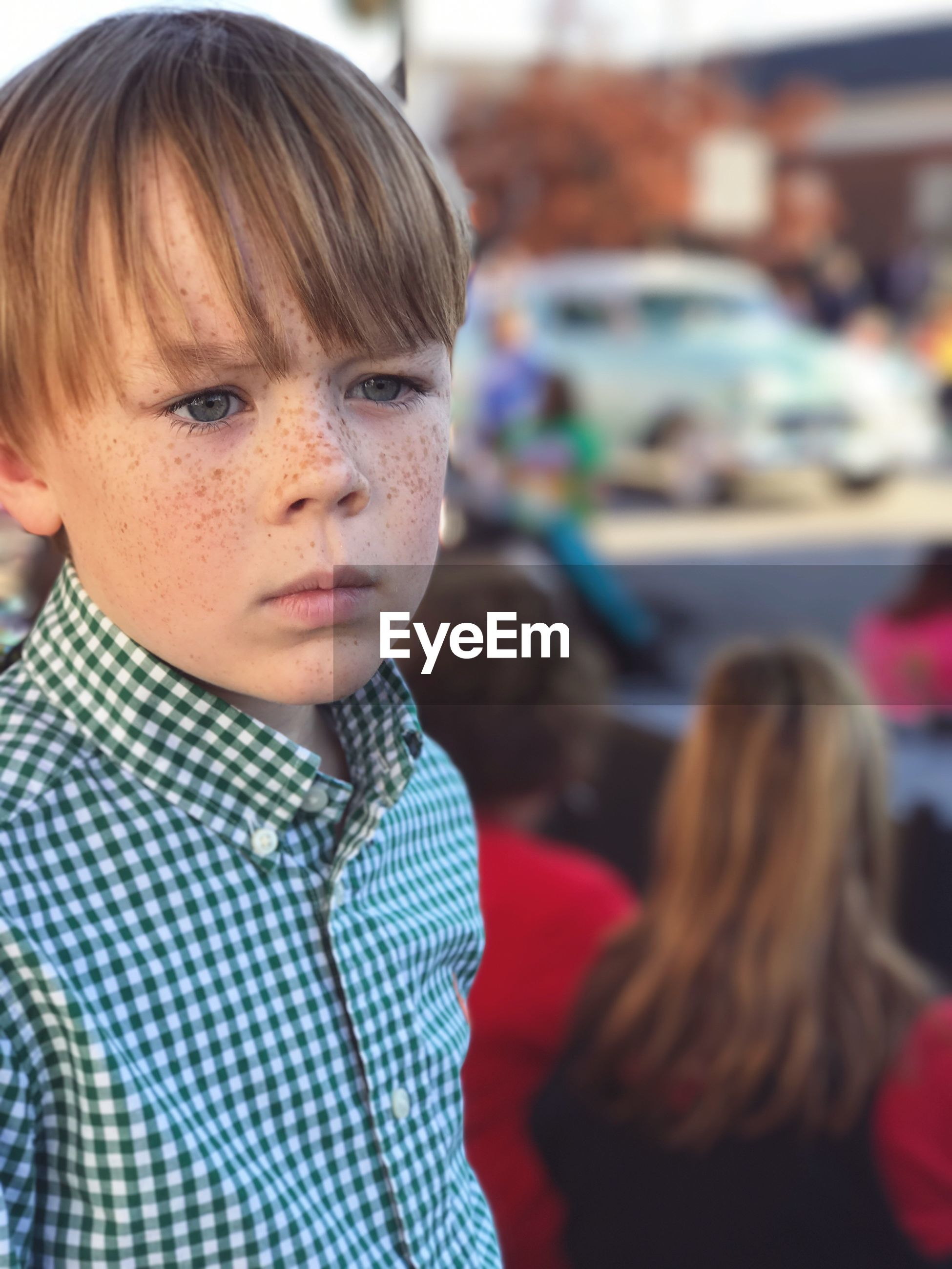 Close-Up Of Boy With Freckles On Face In City